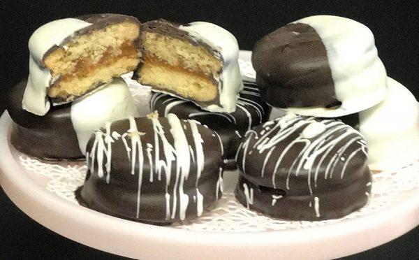 Chocolate Dipped Alfajor Cookies